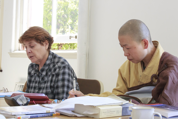 Two Students engaged in the texts in Class