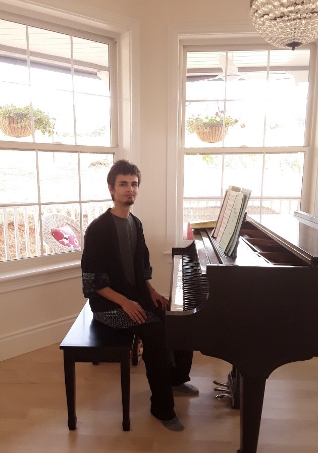 Alex with piano