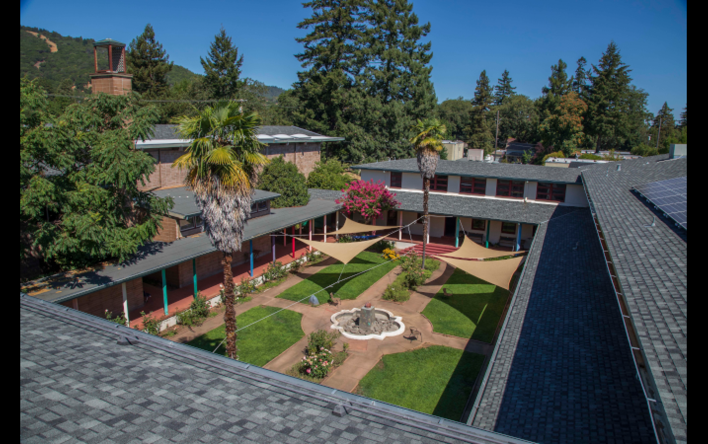 An aerial view of the beautiful Sudhana Center courtyard, complete with new shade sails to help students participate in outdoor gatherings even under the hot August sun.