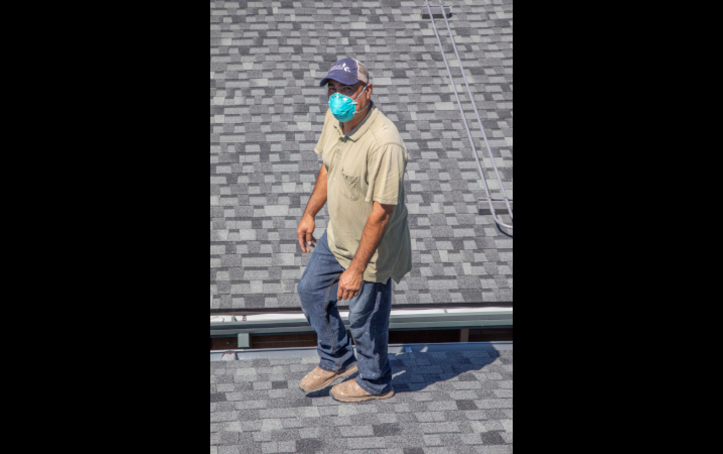 Antonio on a roof, totally at ease. Antonio seems to know how to do everything (HVAC, electric, plumbing, painting, woodwork, detective work… the list goes on) and always does so with such warm-hearted joy.