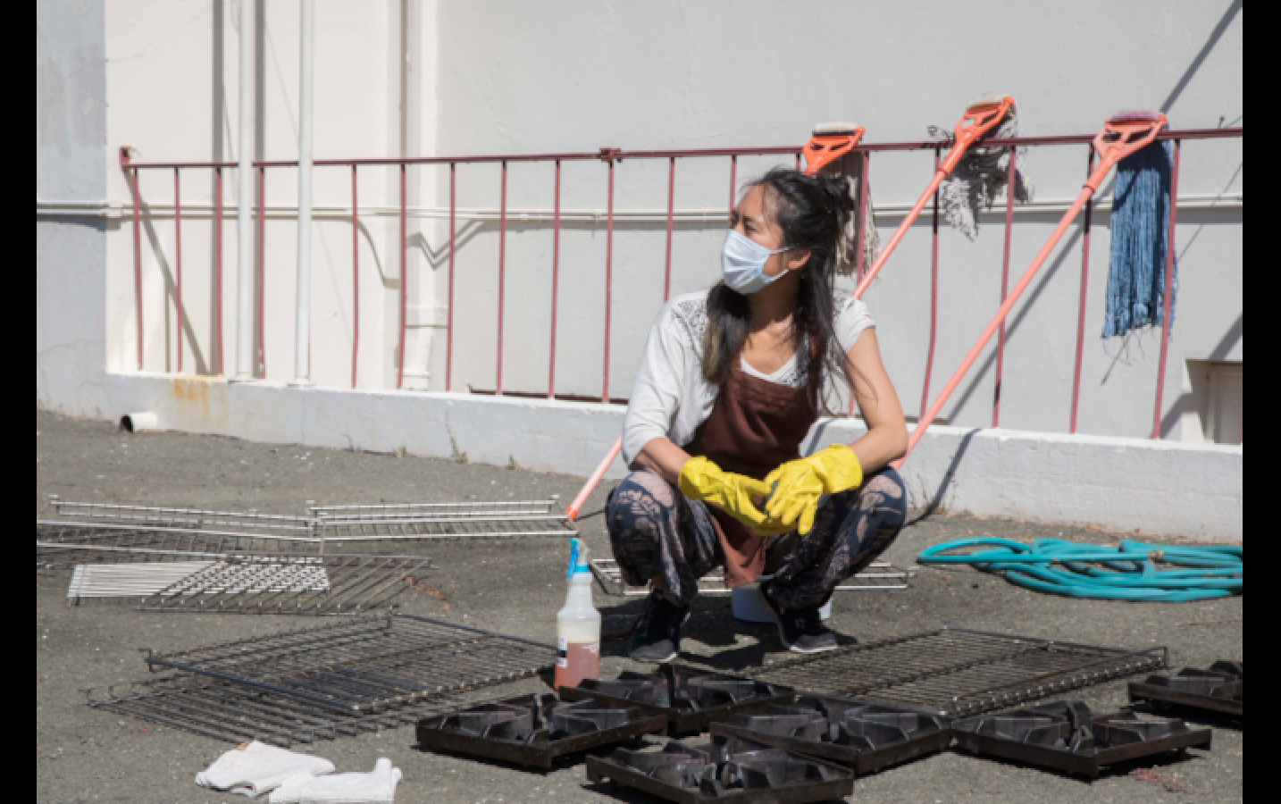 Brenda Li looks contemplatively into the distance, surrounded by kitchenware that she is in the midst of scrubbing down. In their preparations for the students' arrival, the Campus Life team underwent a deep-clean of the entire Sudhana campus.