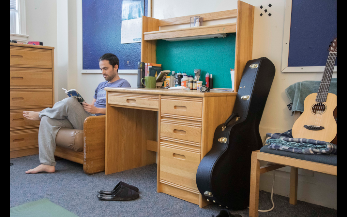 Tomas Fletcher, one of the new RAs for the Men's Dorm at Sudhana, takes a break from his RA training to spend some time lounging in his room.