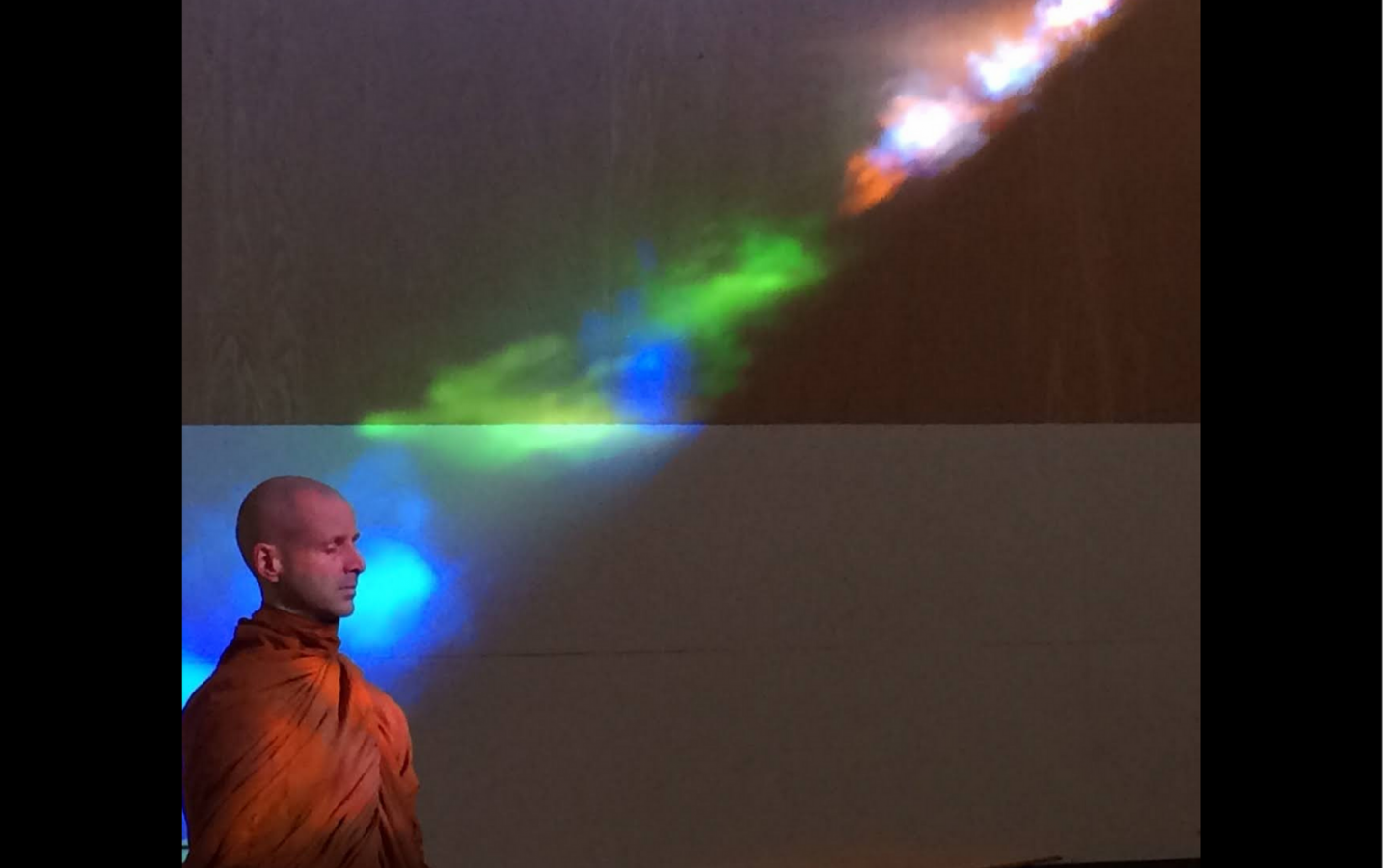 Peacefully abiding in the light of many colors. It was taken during the CEI of Spring 2021 in the Sudhana Center's side Buddha Hall. --Anonymous